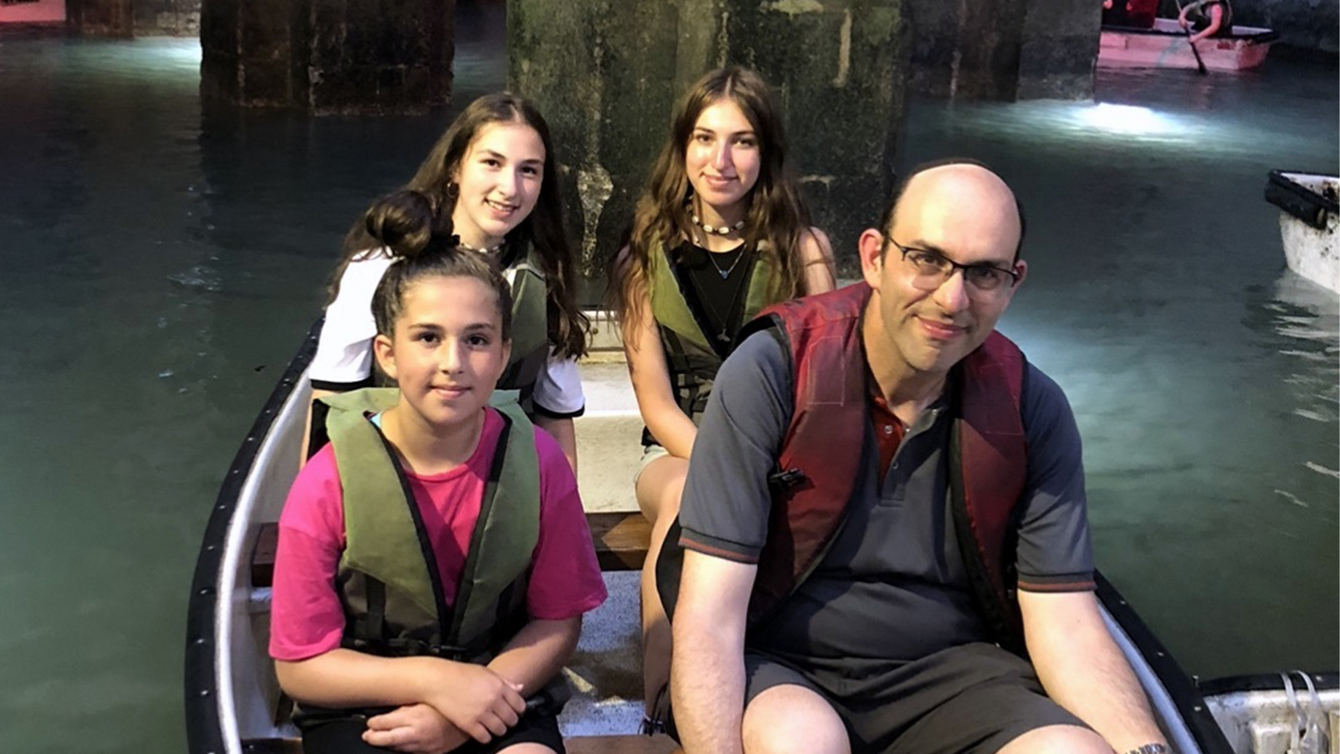 Jeffrey with his three daughters, Abigail, Eliana and Leah in The Arches Pool, Ramla, Israel.